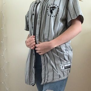 FAMOUS grey and black striped jersey